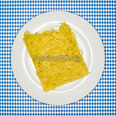 uncooked spaghetti on plate elevated view