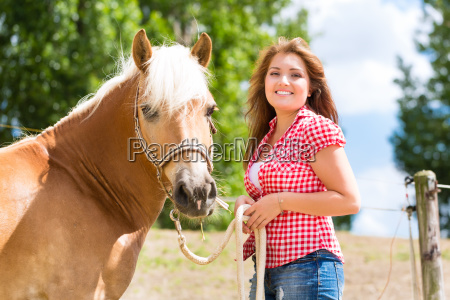 woman with horse on pony farm