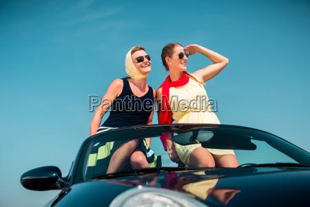 woman having summer trip in convertible