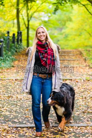 woman walking the dog on leash