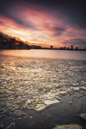 ice floats along the frozen charles