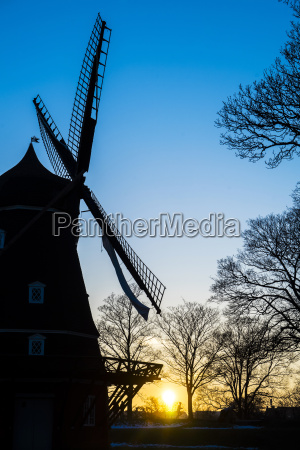 silhouette of windmill at sunset kastellet