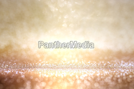 abstrakt guld og solv bokeh baggrund