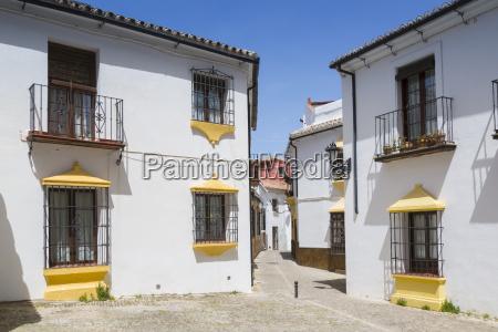 traditional spanish whitewashed houses near plaza