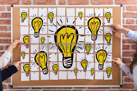 light bulbs drawn on paper notes