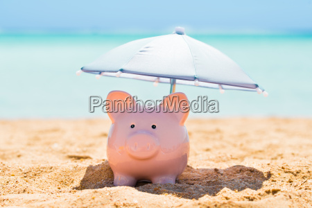 piggy bank under parasol pa strand