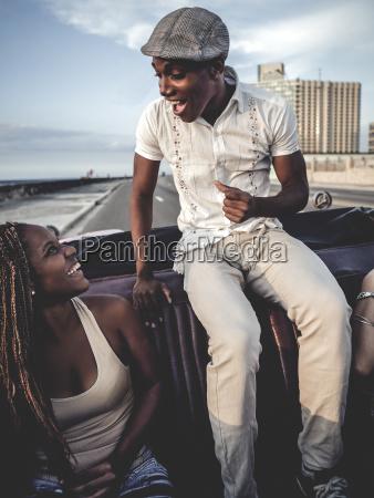 two people riding through an urban