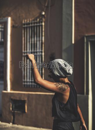 young woman walking along a street