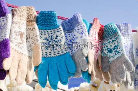 woolen mittens hanging on a rope