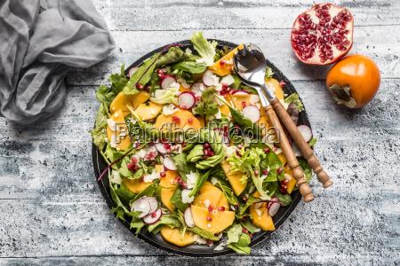 kaki salat med rodt radish granataeble