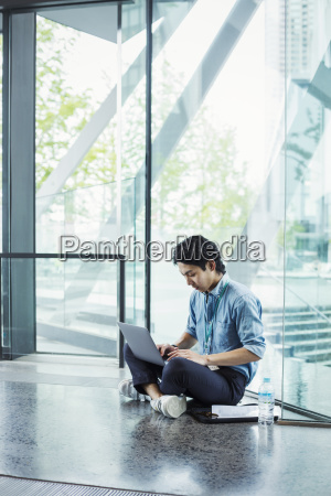 businessman wearing blue shirt sitting on
