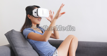 woman watching with virtual reality device