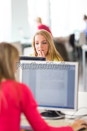 pretty female student looking at a