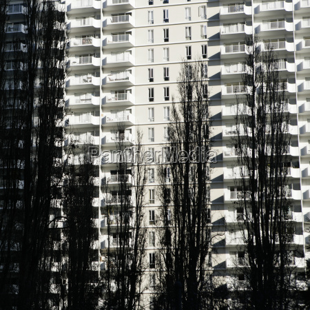 multi story white apartment buildings behind
