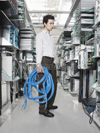 male computer technician holding cat 5