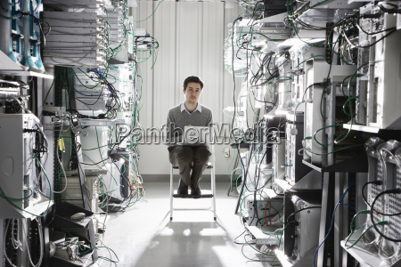 caucasian male technician working on computer
