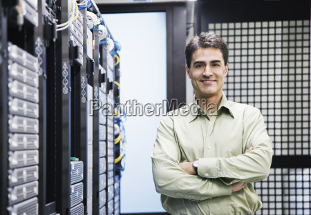 a male computer technician standing in
