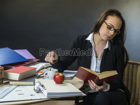 beautiful teacher sitting at her desk