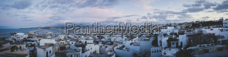 panoramic view of cityscape against cloudy