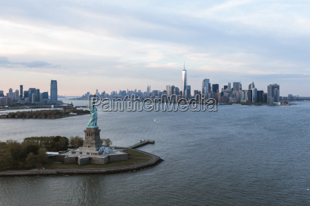 statue of liberty by island in