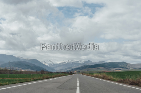 scenic view of road amidst field