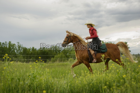 side view of woman riding on
