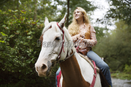 smiling woman looking away while riding