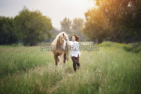 mid adult woman and horse running