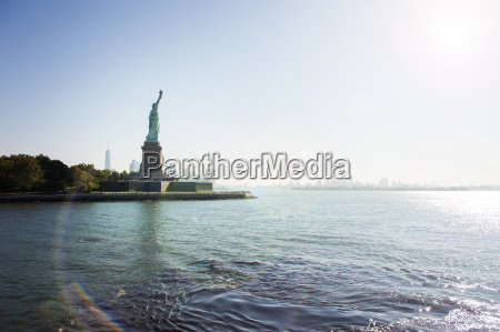 statue of liberty on island against