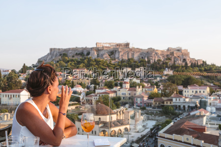 woman looking at townscape while having