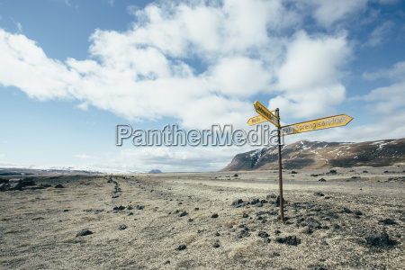 road sign on arid landscape against