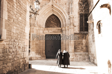 rear view of nuns walking on