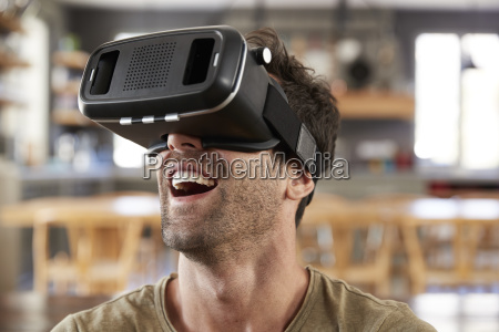man sitting on sofa wearing virtual