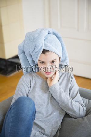 portrait of girl wearing towel turban