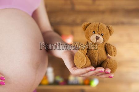 caressing childbearing expecting motherhood parenthood prenatal