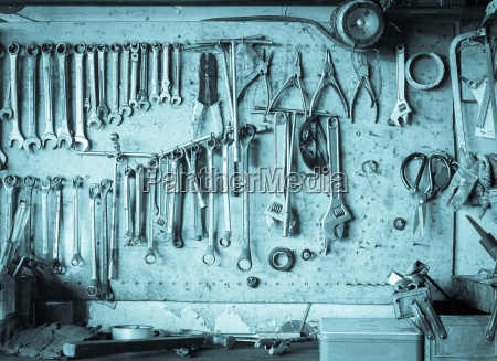 old tool shelf against a wall