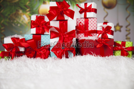 presents with red ribbon on wooden