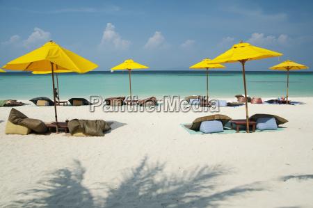 beach umbrellas on phi phi islands