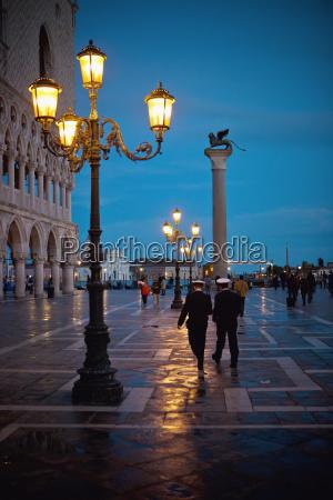 pedestrians walking on the promenade at