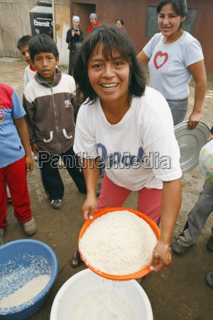 woman with pan of rice lima