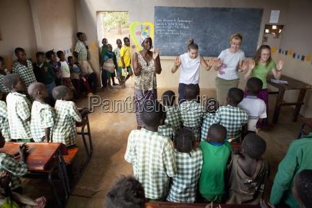 women teaching a classroom of students