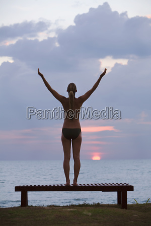 a woman tourist stands on a