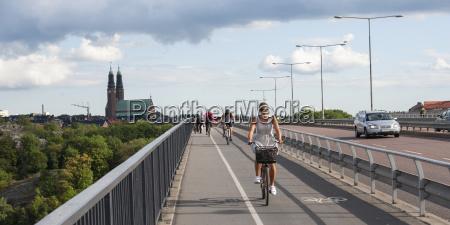 cyclists on a path alongside a