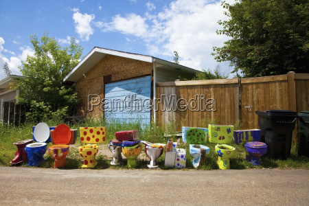 colourful and decorated toilets lined up