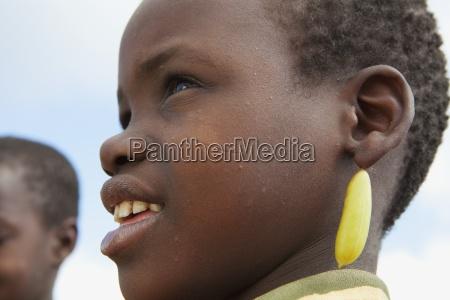 a girl wearing a yellow earring