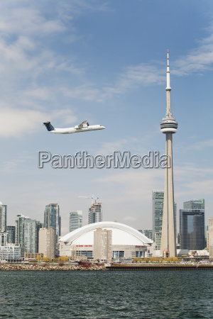 an airplane flying across the skydome