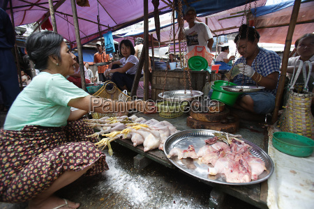 woman running small market stall sells