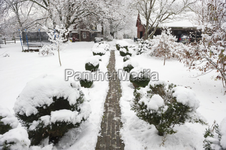 brick pathway at snow covered farm
