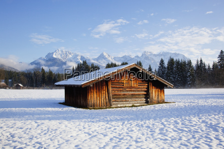 a wooden building in a snow