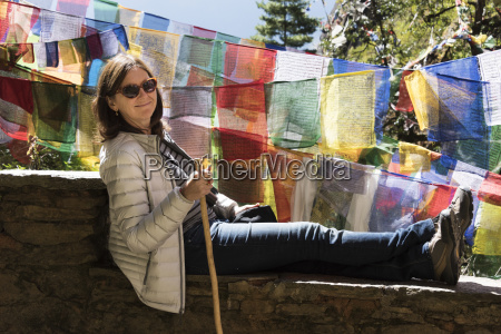 a woman rests on a wall